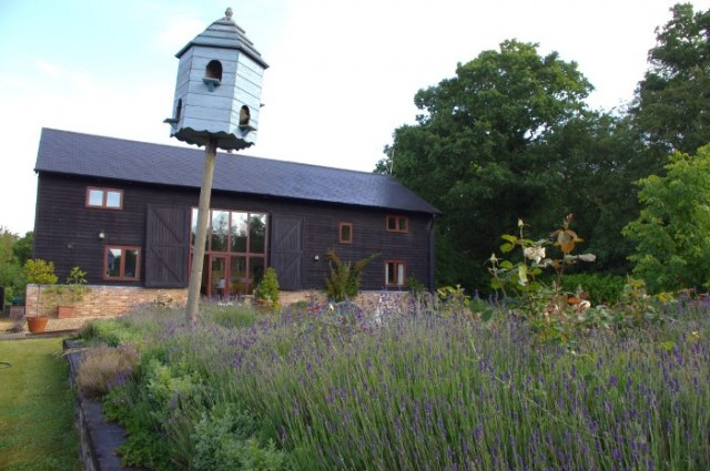 A view of the front and garden of Anstey Grove Barn, high quality bed and breakfast and self-catering accommodation in the Hertfordshire countryside